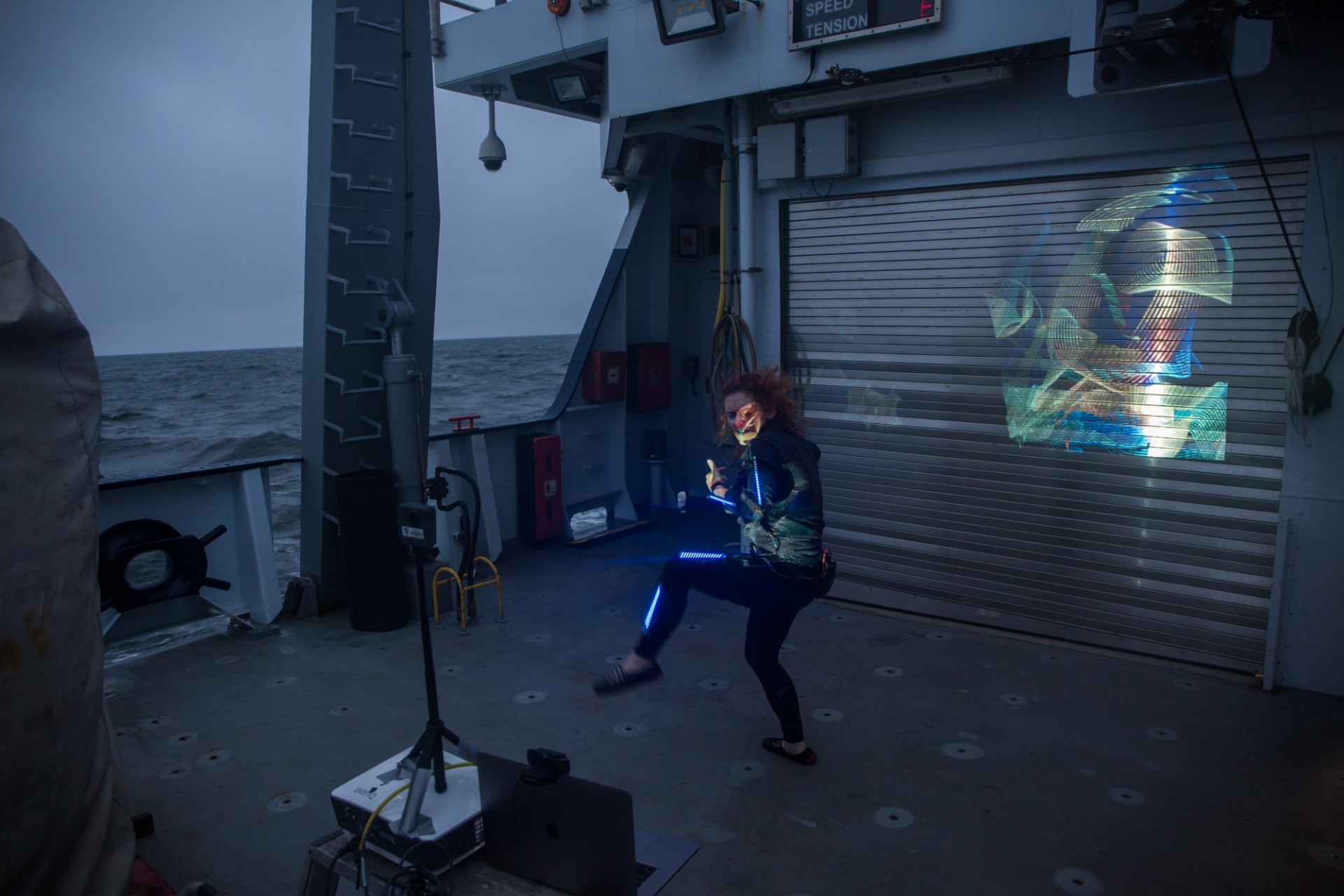Lori performing a light painting piece on the aft deck of R/V Falkor.